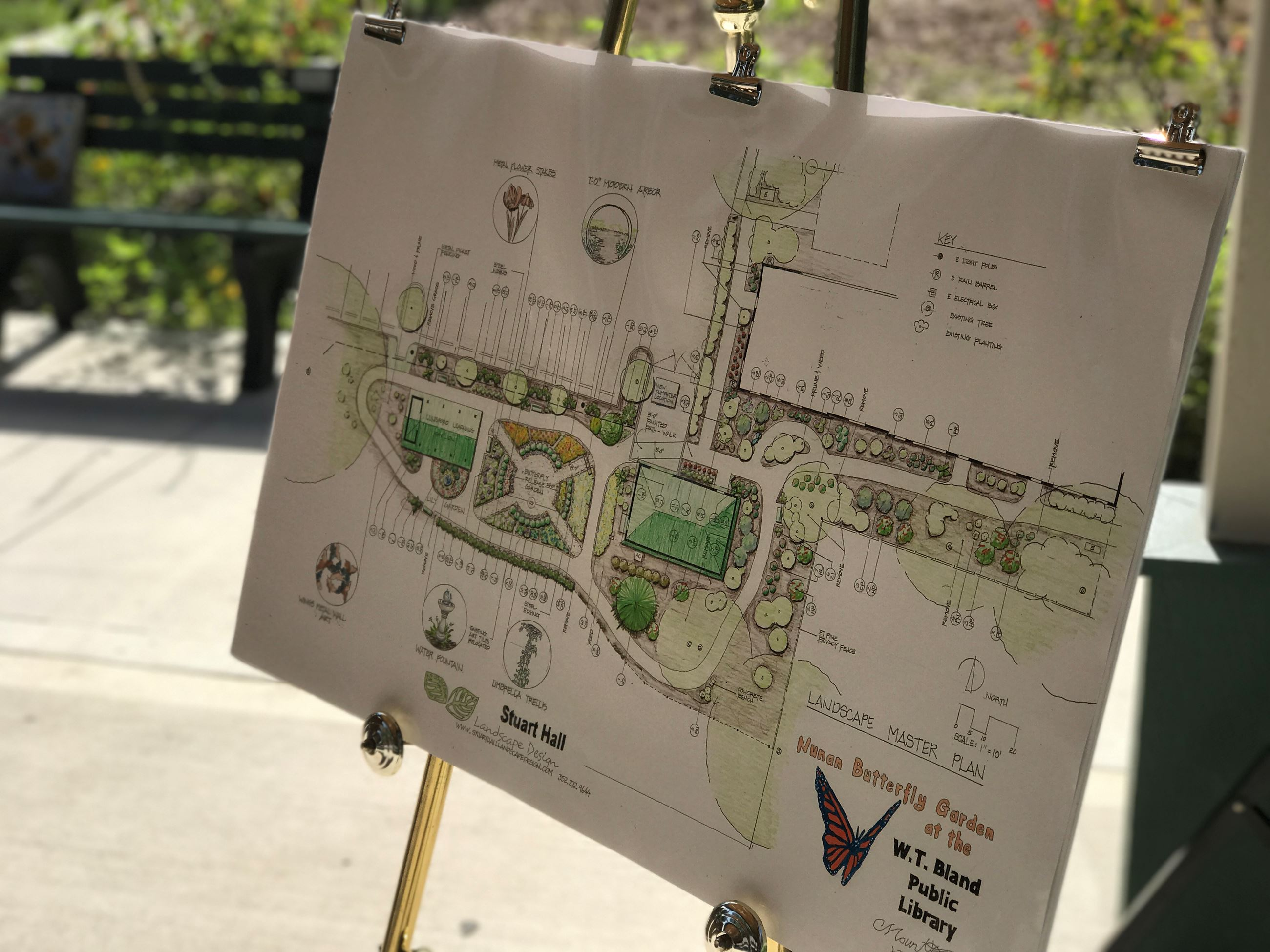 nunan butterfly garden blueprint on display at ribbon cutting