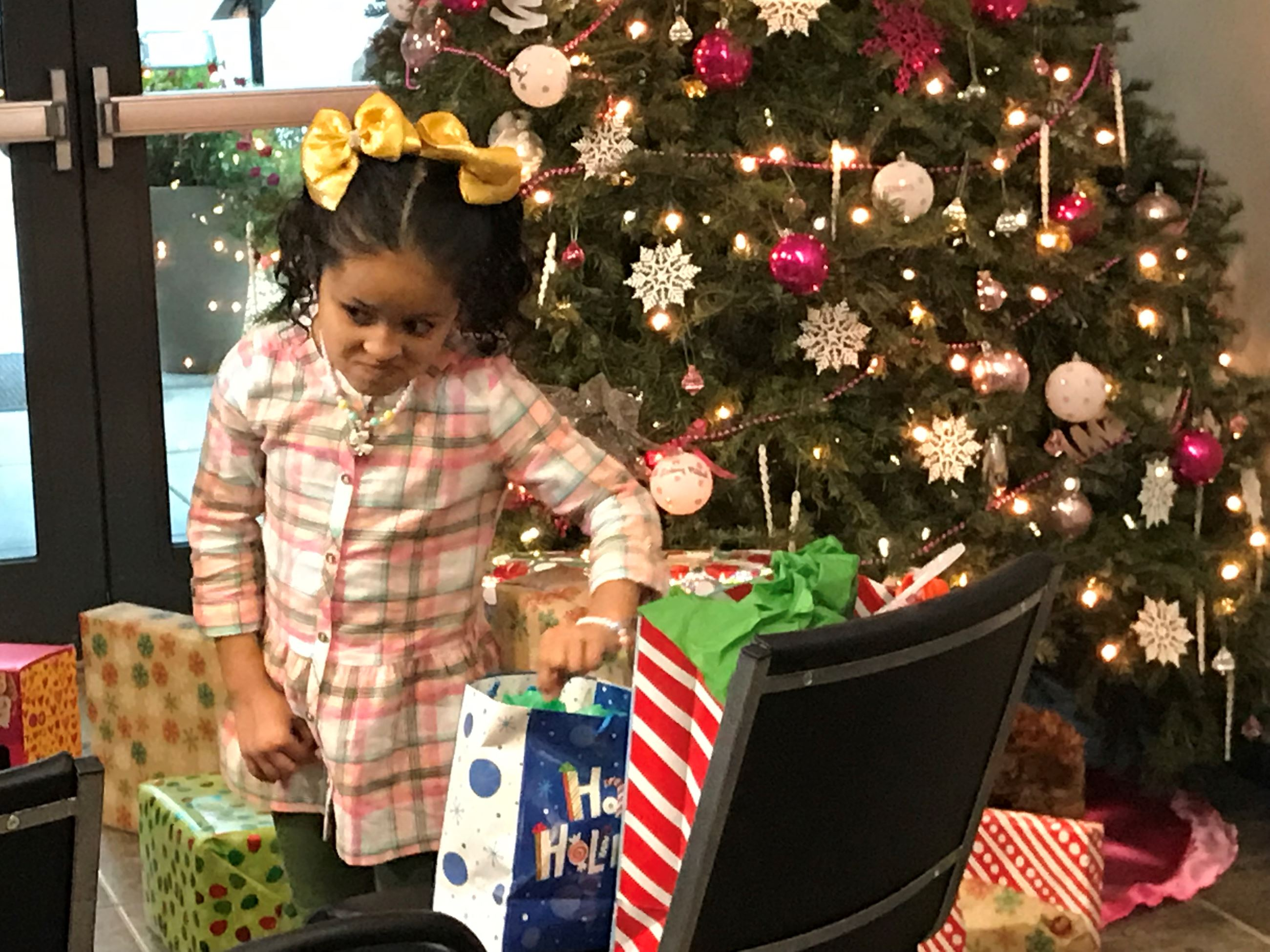Little girl looking at her christmas presents at PD